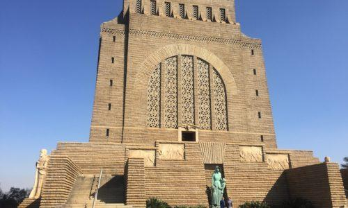 A large square granite building set against a blue sky. the Voortrekker Monument in Pretoria