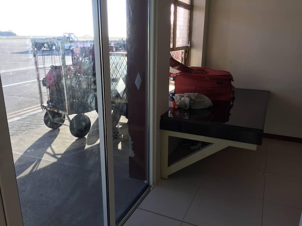Collecting baggage at Mahe Airport