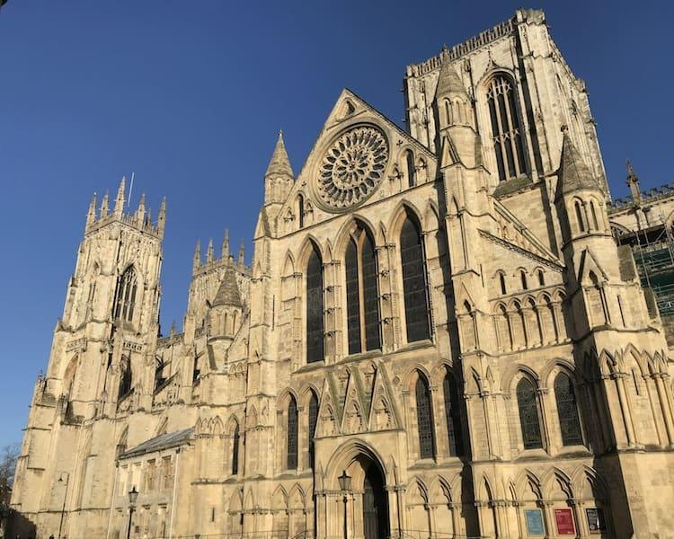 The huge cathedral of Yorkminster on a beautiful blue day.