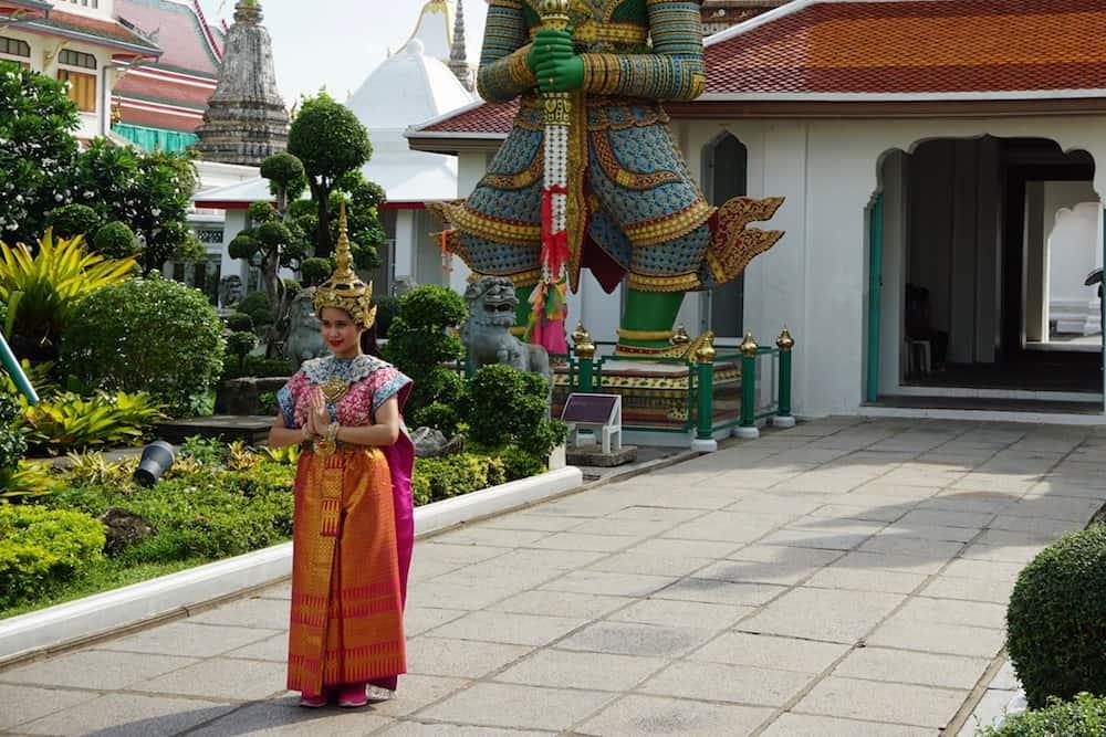 Wat Arun lady in traditional dress
