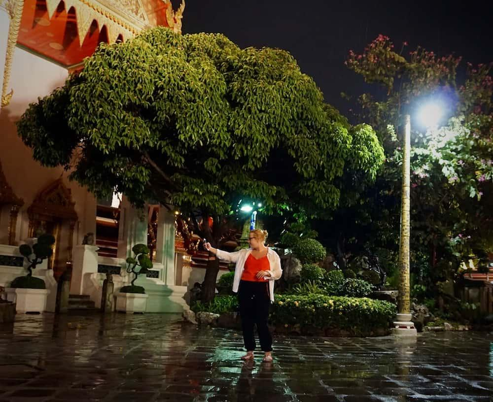 Becca recording a video at Wat Pho
