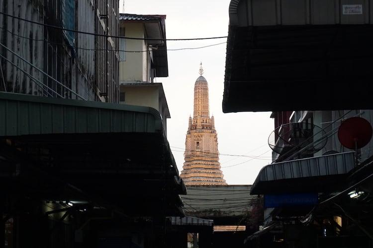 Wat Arun at Sunset from the end of an alleyway