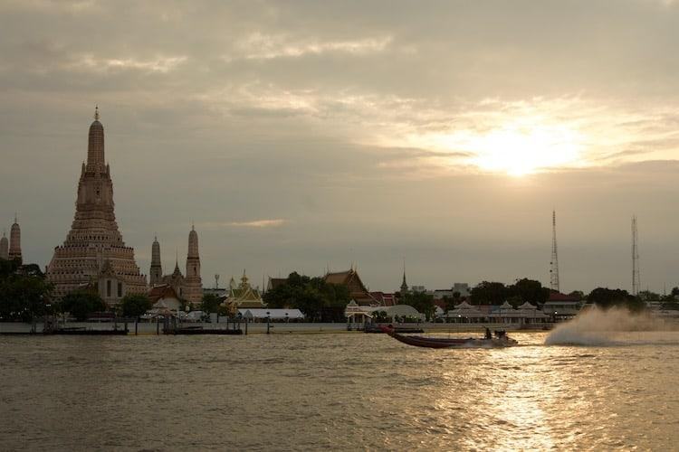 Boat at sunset by Wat Arun