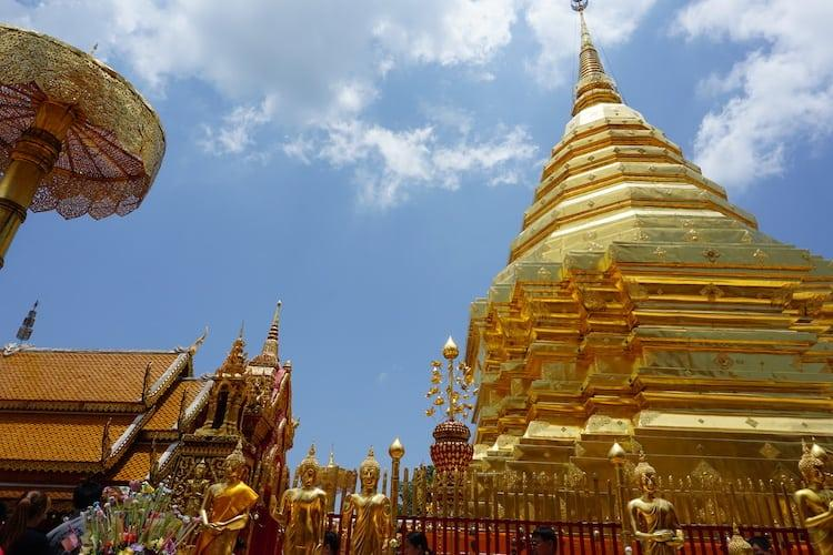 The golden stupid of Doi Suthep with a backdrop of blue skies in Chiang Mai, Thailand
