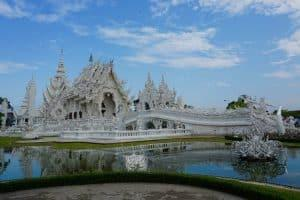 a beautiful white temple in Thailand against a blue sky