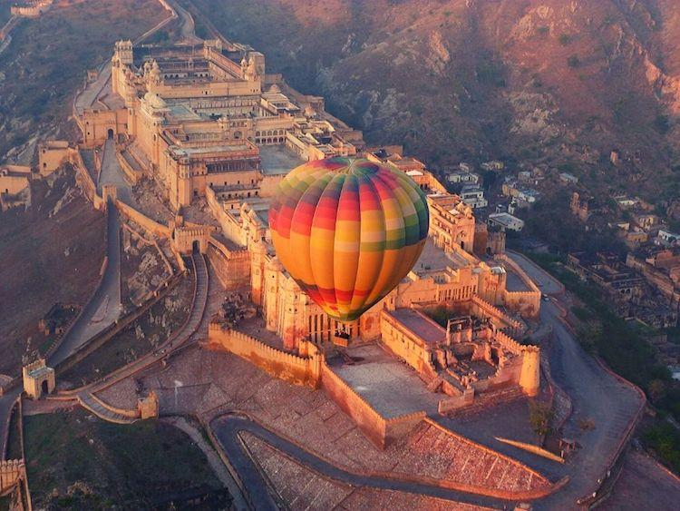 a balloon over the orange fort of Jaipur in India
