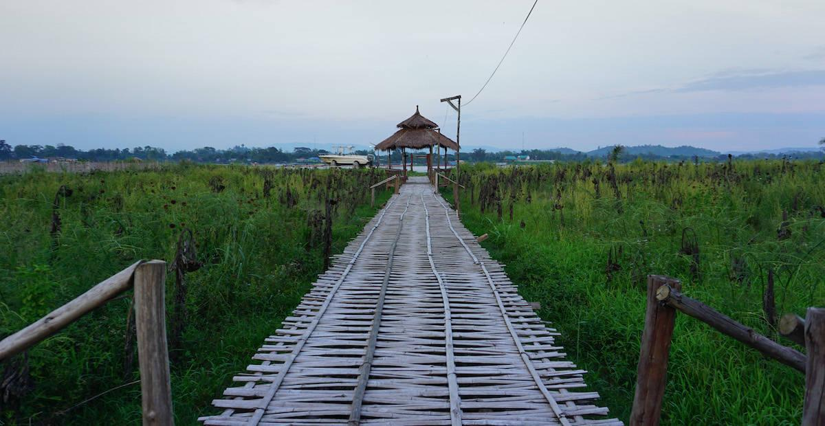 A wooden walkway heading out towards the Mekong river