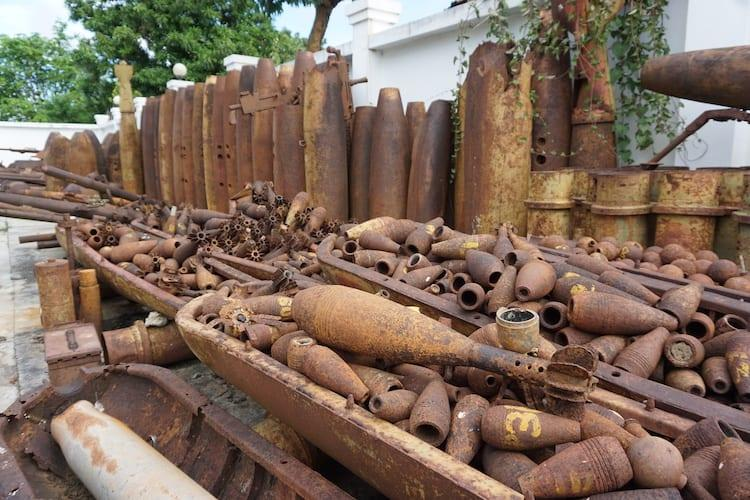 Pile or rusty shells and mortars at Xieng Kouang Tourism Office