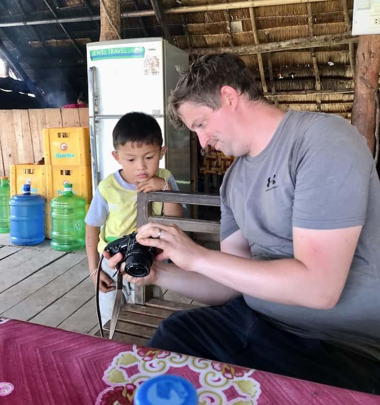 Showing a little boy photos on a digital camera