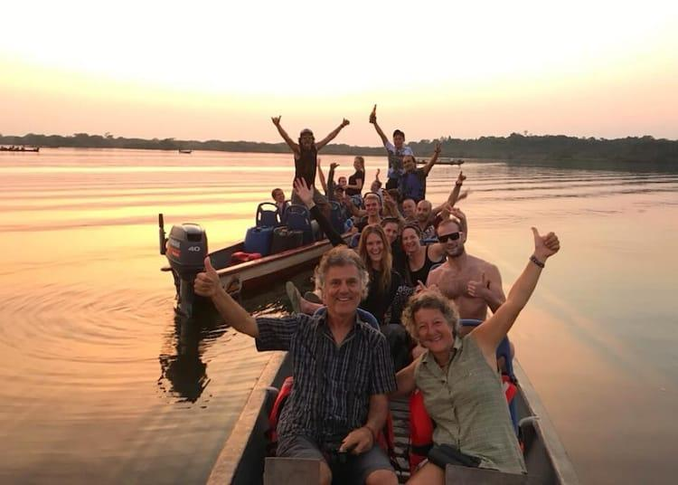 People on a boat in the sunset on the amazon river