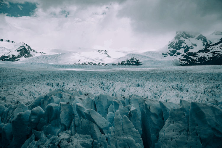 An ice field with a mountain in the distance