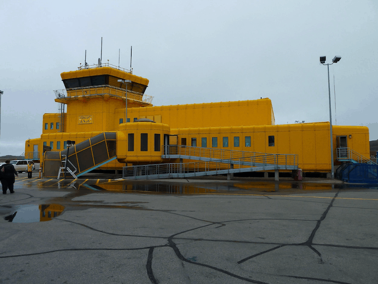 A bright yellow airport terminal of Iqaluit Airport