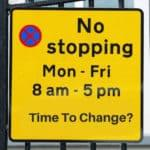 A yellow Uk sign advising people not to stop, but editing to include the words 'time to change'