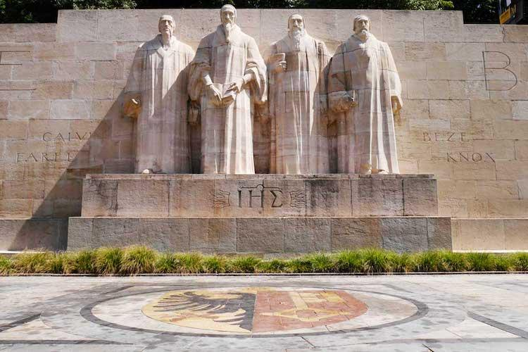 The reformation wall in Geneva, statues of 4 men carved in stone