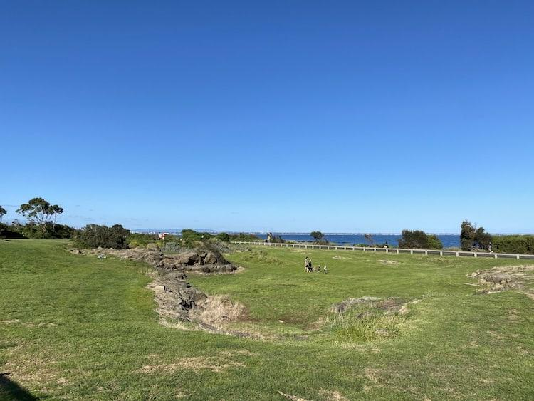 View of Point Gellibrand Quarry, earthworks with blue sea and sky in background