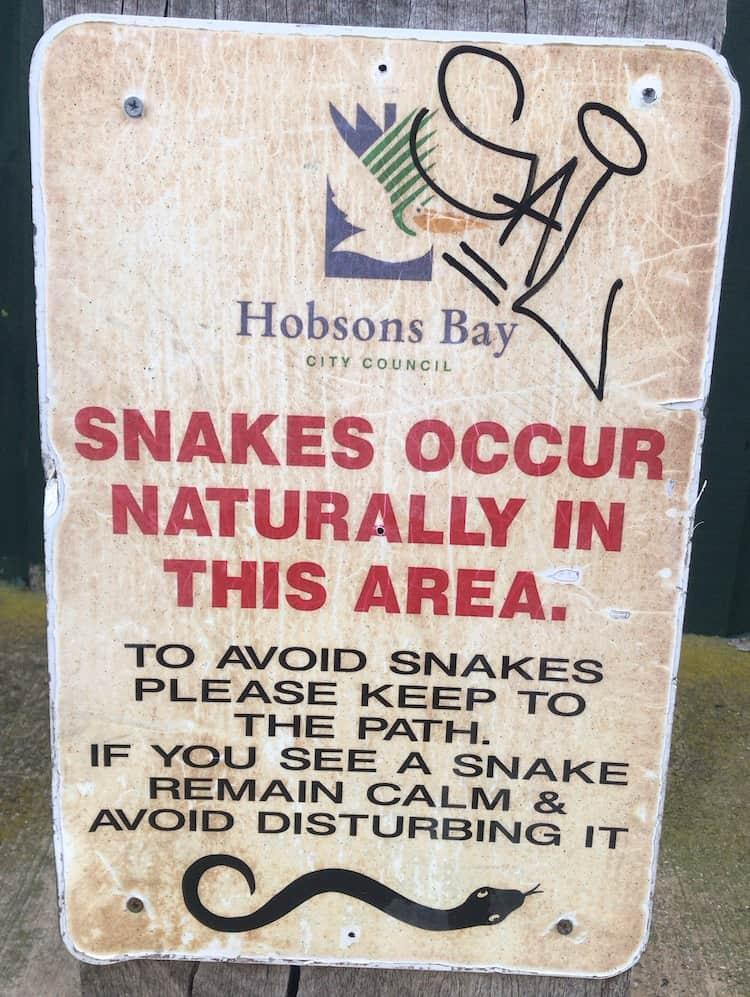 A sign that says snakes occur naturally in the area