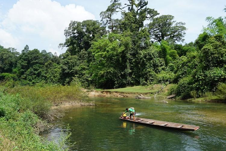 Man Wearing Green In Canoe On Way To Kong Lor Cave