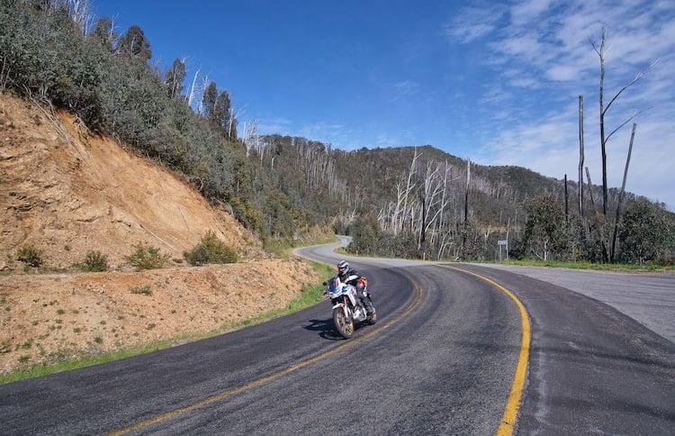 motorbike rounding corner on great alpine road