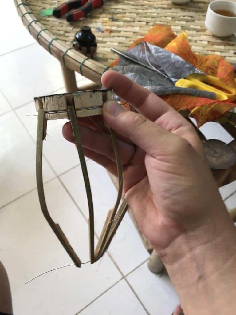 atatching sticks to a vietnamese lantern frame