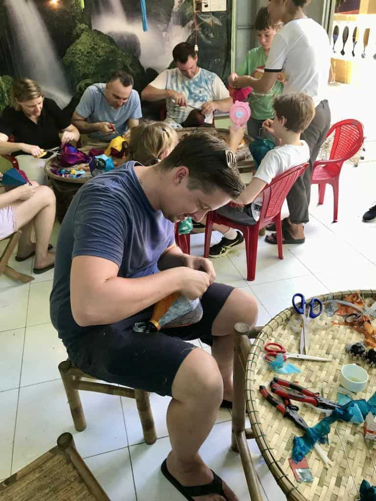 attaching a tassel on vietnamese lantern